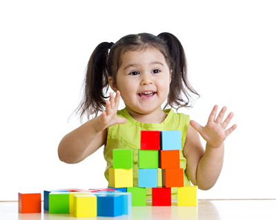 Children play with building blocks Stock Photo